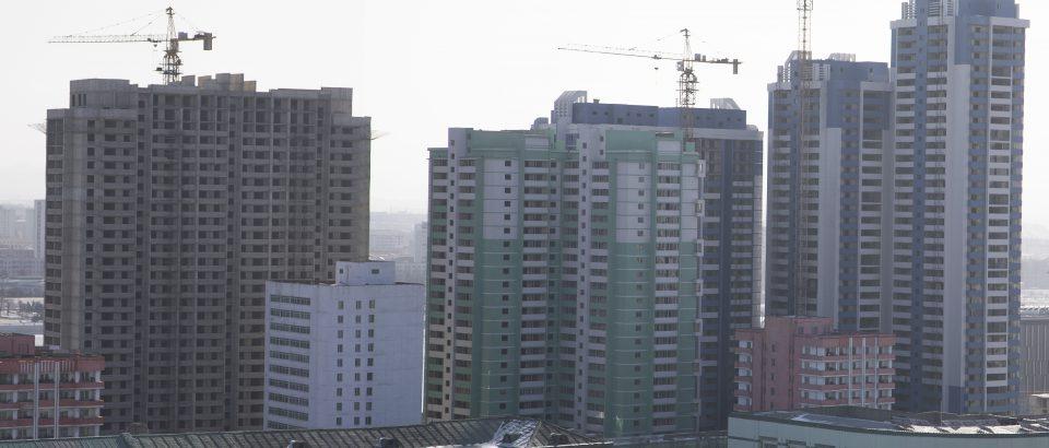 Towerblock construction surrounding Kim Il Sung square slows, photos show