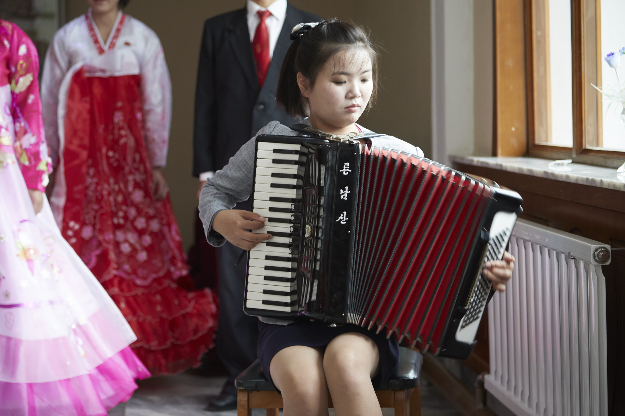 Accordions and fake beards: North Korean exports to China fall slightly in July