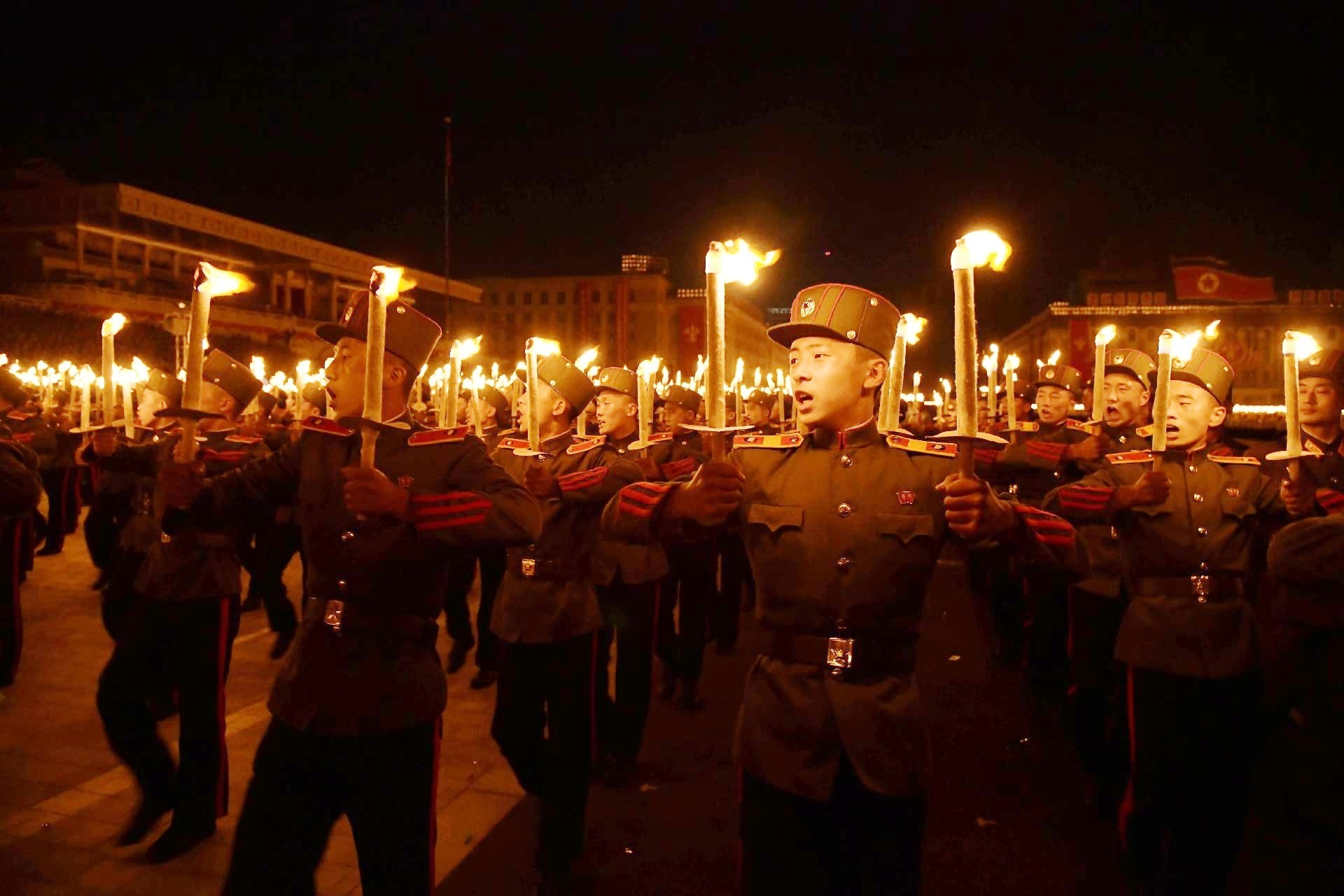 North Koreans prepare for torch march, but no signs of military parade
