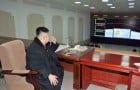 North Korean leader Kim Jong-Un smokes a cigarette at the General Satellite Control and Command Center in this picture released by the North's KCNA news agency in Pyongyang
