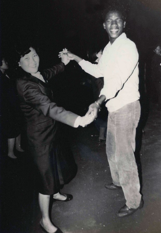 Aliou dancing with a stranger, assigned to him, on Kim Il Sung's Birthday, 1984