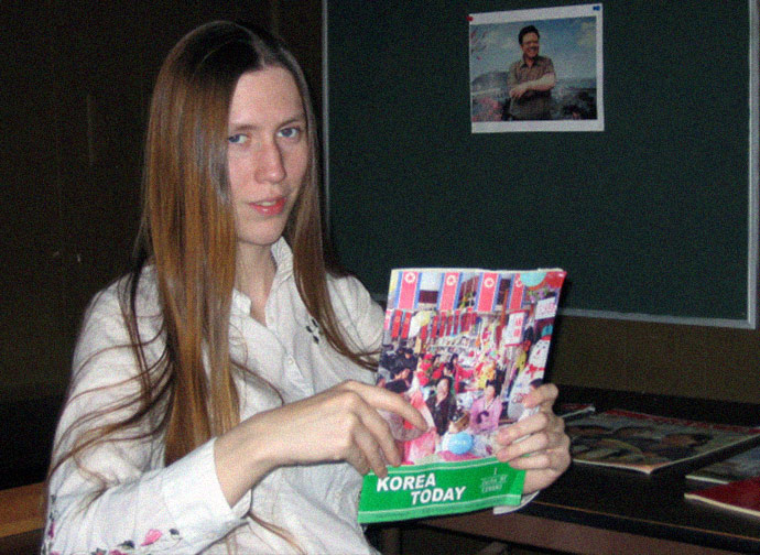 "Jillian Hoy—or ""comrade Morrison"" of the pro North Korean Rural people's party holding a Korean trade magazine sent to them by the Pyongyang government in 2008. The photo is from inside the mobile home in rural South Carolina that served as headquarters for the RPP."
