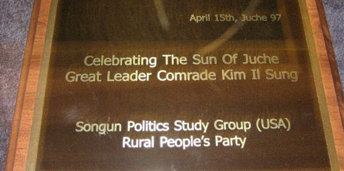 A plaque presented by the Rural People's Party and Songun Politics Study Group to Kim Jong Il on