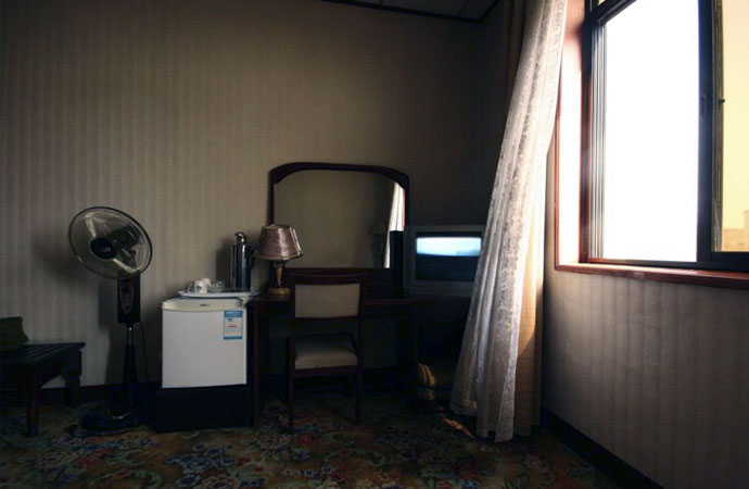 Window from an open window moves a curtain in a hotel room in Rajin, North Korea. (Picture: NK News)