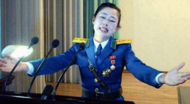 "PYONGYANG TRAFFIC GIRL AWARDED TITLE ""HERO OF THE DPRK"" Traffic-lady-gets-medal-does-speech-620x340"
