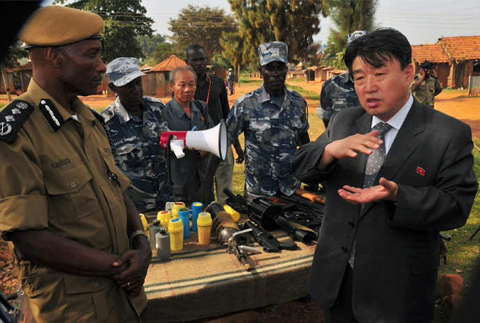 1-full-size-north-korean-peoples-security-minister-holds-tear-gas-gun-in-uganda