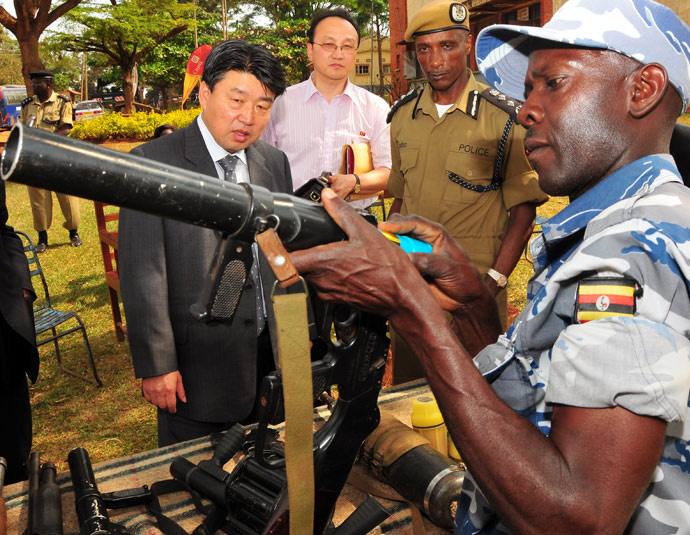 2-full-size-north-korean-peoples-security-minister-holds-tear-gas-gun-in-uganda