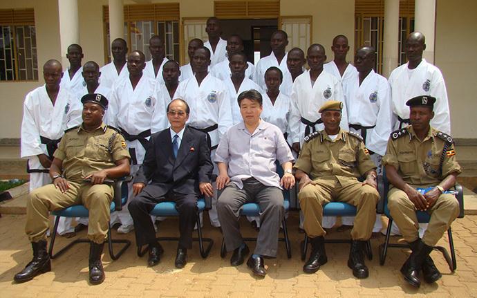 North-korean-officials-with-taekwondo-team-of-uganda