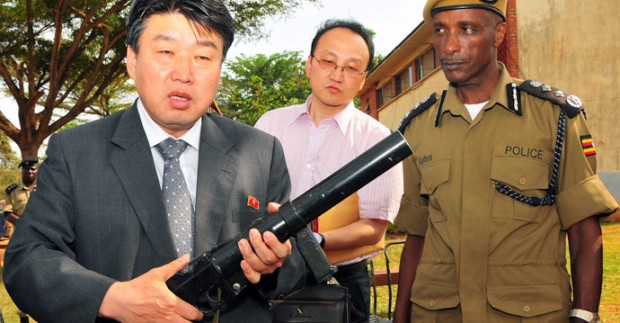 north-korean-peoples-security-minister-holds-tear-gas-gun-in-uganda North Korean Vice Minister for People's Security, Ri Song Chol, left, during his June visit, with Uganda's Inspector General of Police, Gen. Kale Kayihura, right.