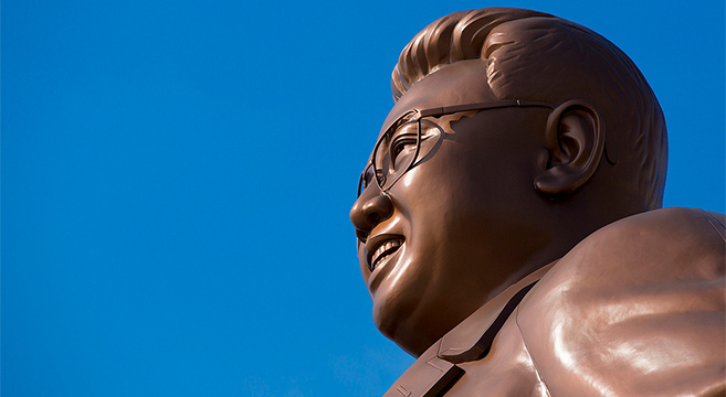 Close up of Kim Jong Il statue at Munsu Hill, Pyongyang | Picture: E. Lafforgue