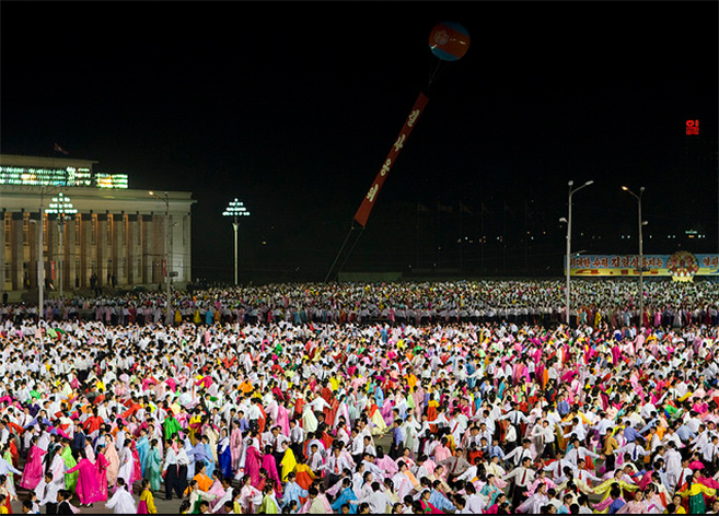 People dance in Kim Il Sung Sqaure for April 15 celebrations | Picture: E. Lafforgue