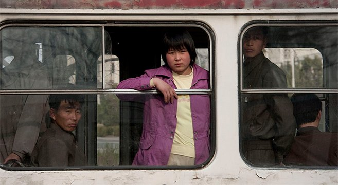 People ride a tram, Pyongyang | Picture: E. Lafforgue