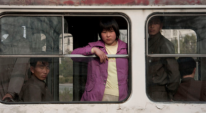 People ride a tram, Pyongyang   Picture: E. Lafforgue