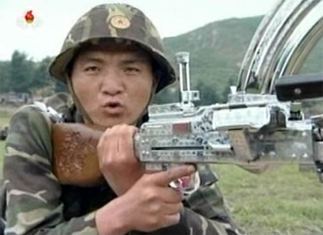 Soldier showing off an engraved, chrome-plated weapon | Picture: KCTV