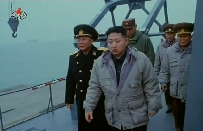 Kim Jong Un walking in front of a missile rack on a surface effect ship | Photo: KCTV