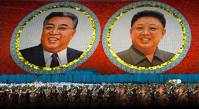 Portraits of the Kims at 2012 Mass Games | Picture: E. Lafforgue
