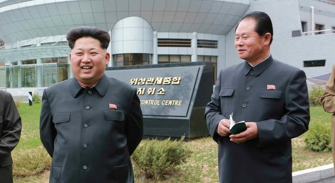 Hong Yong Chil and KJU at General Satellite Control and Command Center | Photo: KCNA