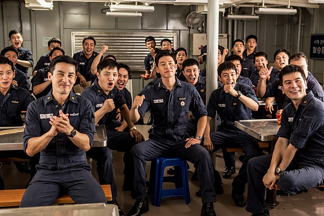 Naval soldiers cheering S.Korean soccer team for the World Cup competition