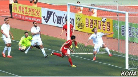 North Korean soccer match features conspicuous ads