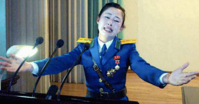Pyongyang traffic girl given mystery hero award