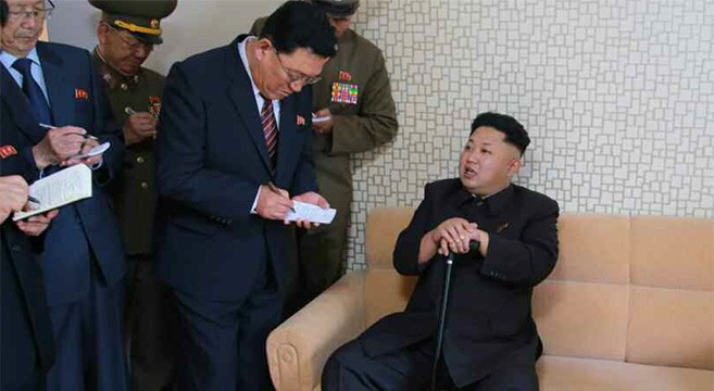 Kim Jong Un reappears with cane, state media shows (Updated with photo)