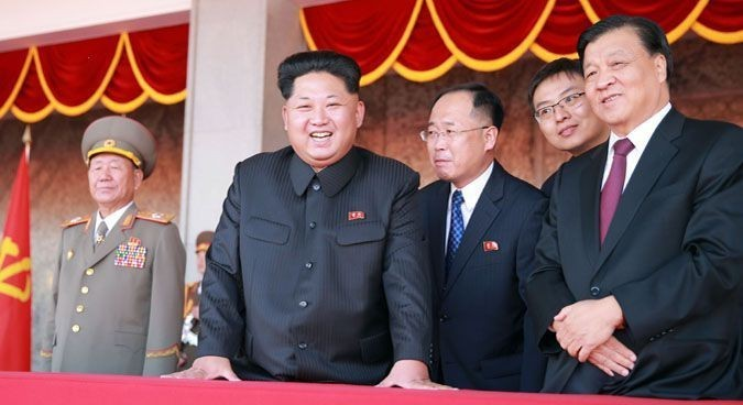 Liu Yunshan (right) joins Kim Jong Un in the reviewing stand for the military parade, October 10 | Photo: KCNA
