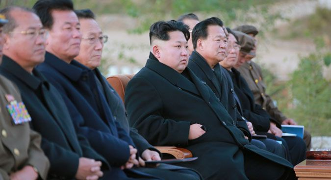 Kim Jong Un and Choe Ryong Hae (right of Kim) in October | Photo: KCNA