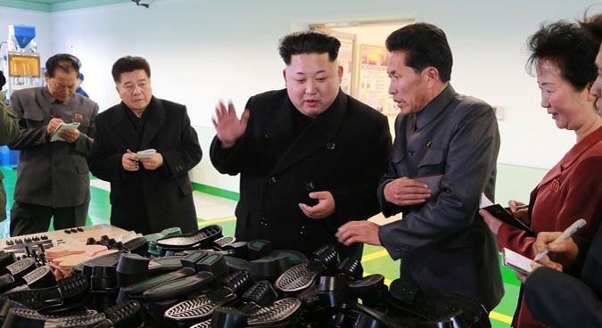 Han Kwang Sang (second from left) with Kim Jong Un at Wonsan Shoes Factory in January | Photo: KCNA