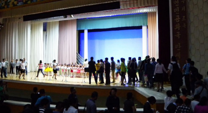 Chinese tourists pose for photos, post-performance | Picture: NK News