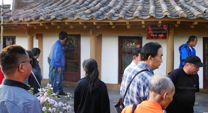 Chinese tourists view a local attraction | Picture: NK News