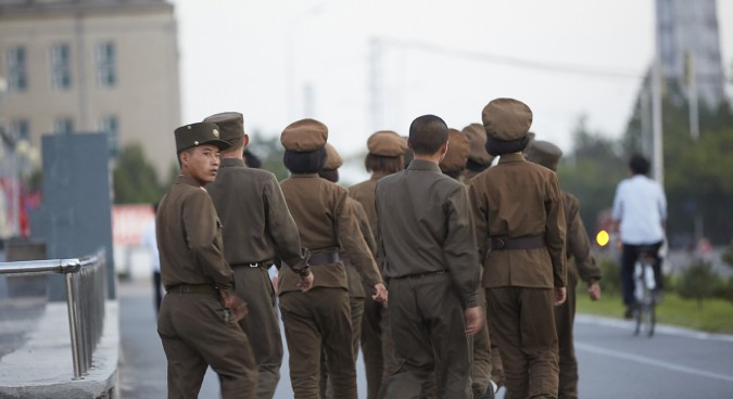 North Korean young people  clad in uniform walking on street | Credit: NK News