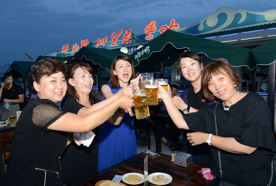Participants with smile toast with beer at the festival Image credit: Uriminzokkiri