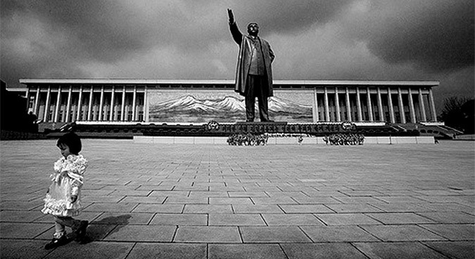 Girl walks past statue of Kim Il Sung, Pyongyang, 2008 | Picture: Eric Lafforgue