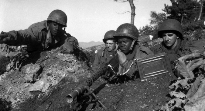 Fighting with the 2nd Inf. Div. north of the Chongchon River, Sfc. Major Cleveland, weapons squad leader, points out communist-led North Korean position to his machine gun crew.  November 20, 1950.  Pfc. James Cox. (Army) NARA FILE #:  111-SC-353469 WAR & CONFLICT BOOK #:  1426