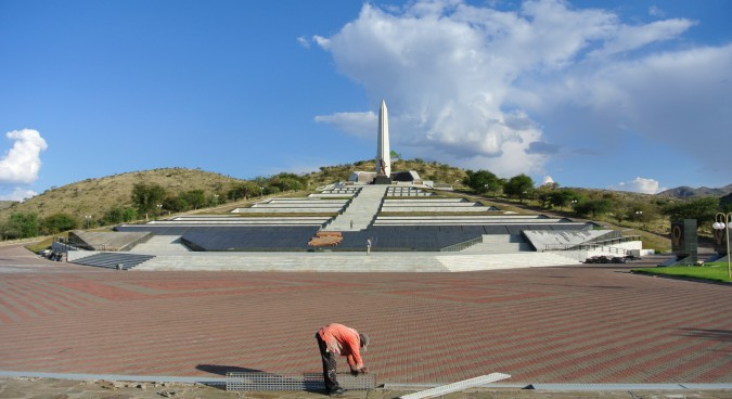 A worker cleans out the rain gutters at Heroes Acre, built in 2002 by Mansudae Overseas at a cost of about R70 million on Windhoek's outskirts