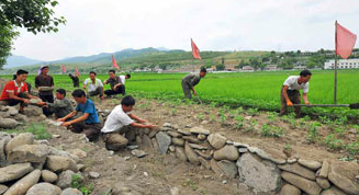 N. Korean media urges simultaneous action against flooding, drought