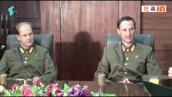 Sons of defector American reappear in N. Korean media, confirm father's death