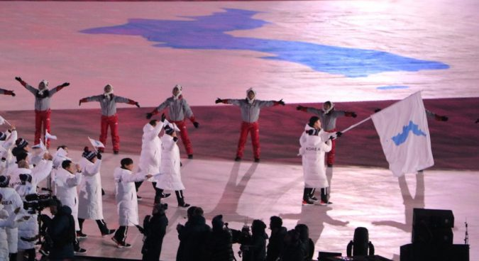 Two Koreas march under unification flag at Winter Olympics Opening Ceremony