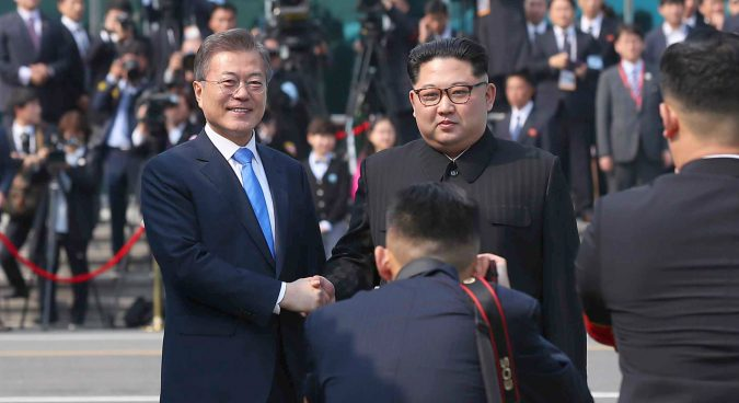 Kim Jong Un and Moon Jae-in share historic first handshake at Panmunjom