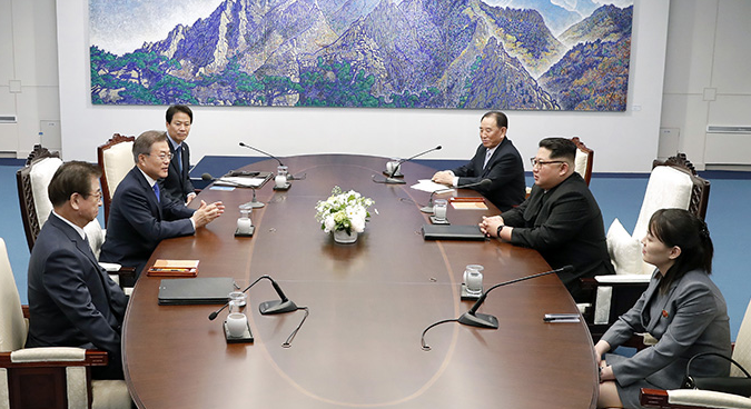 """In morning meeting with Moon, Kim Jong Un makes rare reference to """"defectors"""""""