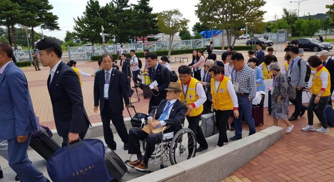Two Koreas begin first family reunions in almost three years