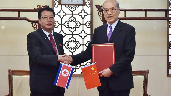 Chinese, North Korean central prosecutors' offices sign agreement in Beijing