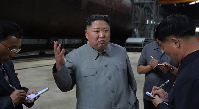 Why Kim's submarine visit leaves room for talks, but reflects hardening position