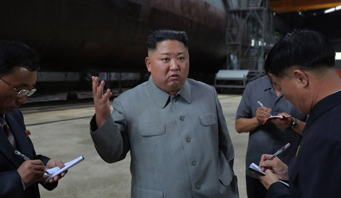 """Kim Jong Un inspects """"newly-built"""" submarine, state media says"""
