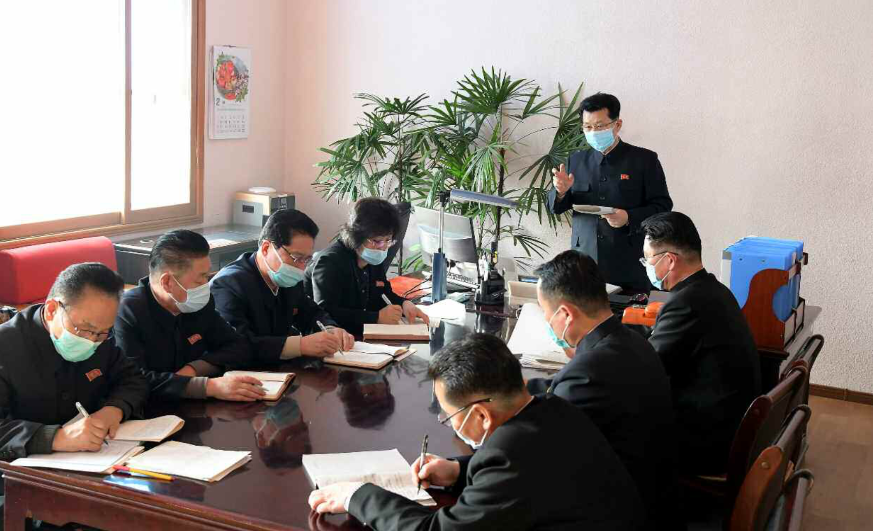 Mask-clad North Korean Premier visits coronavirus quarantine workers