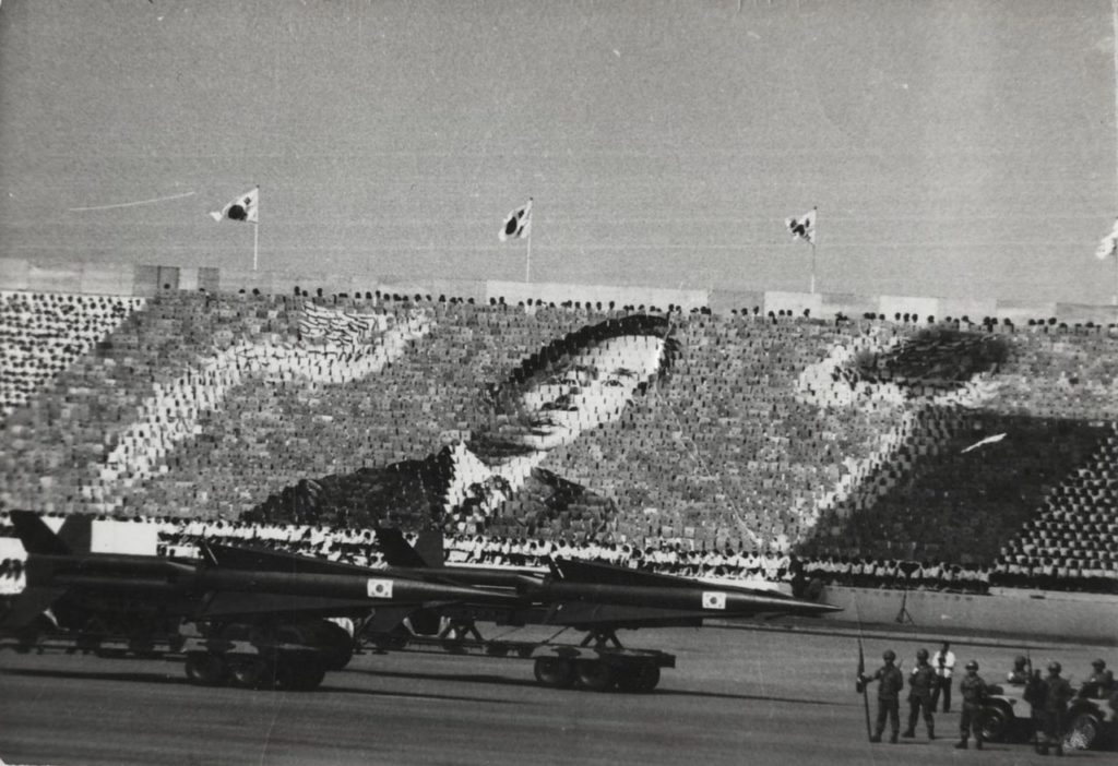South Korea's Hyunmoo-1 missile is on display with individuals collectively holding up cards depicting then-President Park Chung-hee during an Armed Forces Day parade in 1973. | Image: Baek Jong-sik, Wikimedia Commons