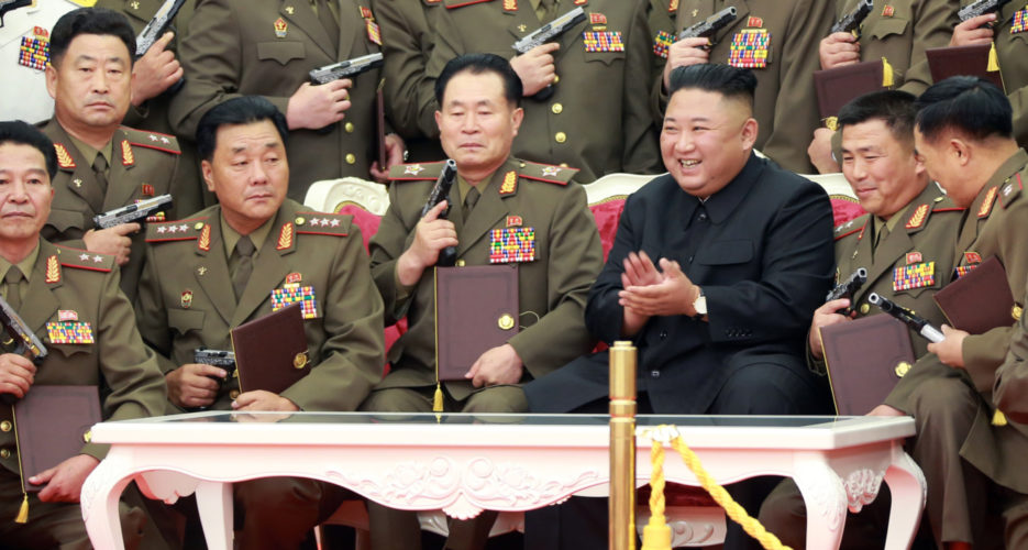 Kim Jong Un gifts guns to army officers as North Korea marks war anniversary