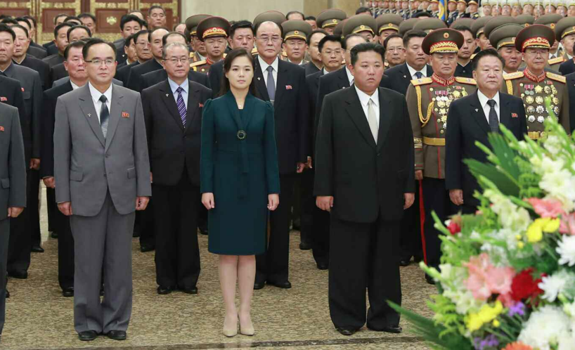 Kim Jong Un visits shrine with wife, meets military parade paratroopers