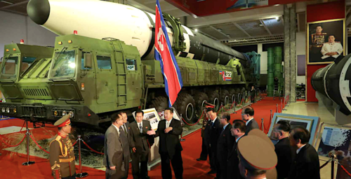Standing in front of nuclear missiles, Kim Jong Un says US causing 'tension'