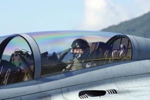 Need for speed? Moon rides fighter jet, promotes South Korea's defense sector